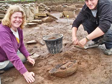 Sarah and Woody prepare the massive pot base for lifting.