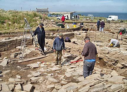 Ray, Mick and Jim recording and removing the roof tile horizon in Structure Twelve.