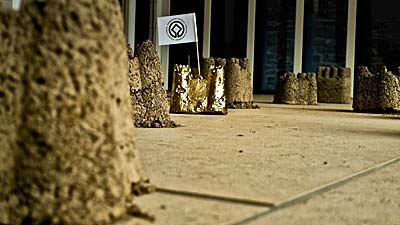 Spoil(castles) and Spoilcastle (Gold) Ness of Brodgar archaeological excavations spoil heap dirt / (plus, for golden) PVA glue, gold paint and home-made UNESCO World Heritage Convention flag Being and Remembering: new work by Rik Hammond - The Pier Arts Centre 2012 Photo: Fionn McArthur