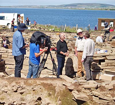 Site director Nick Card being interviewed by Sir Tony Robinson and Francis Pryor.