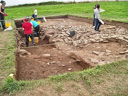 Planning proceeds in Trench T, as the sondage gets deeper and more of the mound structure is revealed.