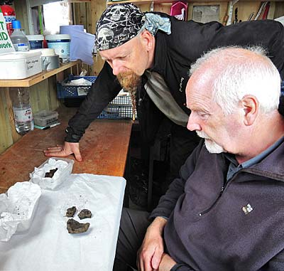 Mike and Roy examine the new carinated bowl sherds from under Structure Fourteen.