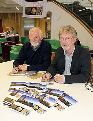 Roy Towers and Nick Card signing copies of the new Ness of Brodgar guidebook at the official launch in Kirkwall.