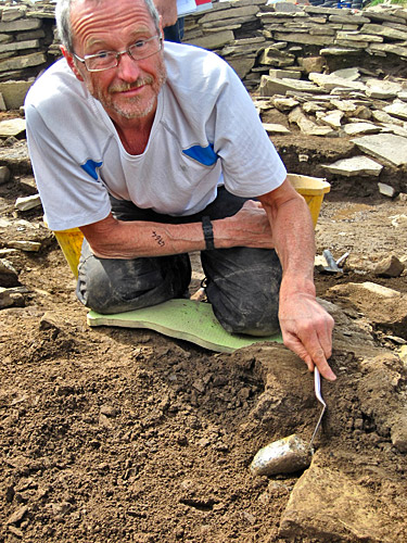 Chris Crisp discovers another cushion stone from the south of Structure Eight.