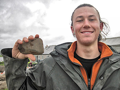 Beginner's luck! Miles seems happy with his polished stone axe.