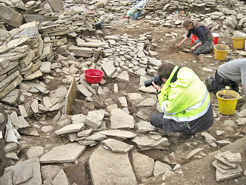 Ola photographs another new decorated stone that came to light in the Central Midden Area — is it related to the elusive Structure Twenty-Three?