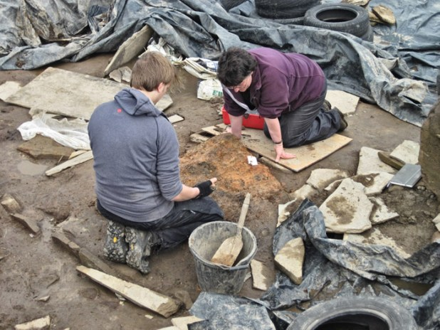 Sam and Cathy prepare a burnt area for archaeomagnetic sampling in Structure Eight.