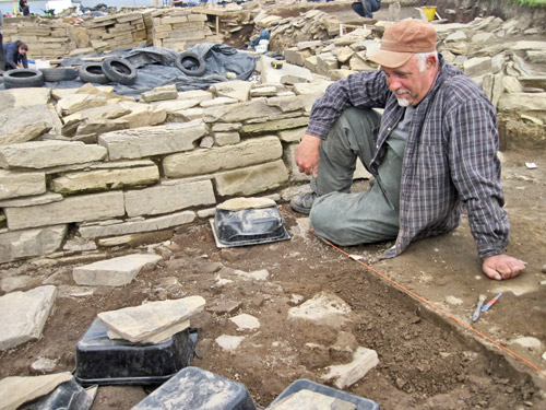 Colin puzzles over his next move in recovering the large pot spread outside the southern blocked entrance to Structure Twelve.
