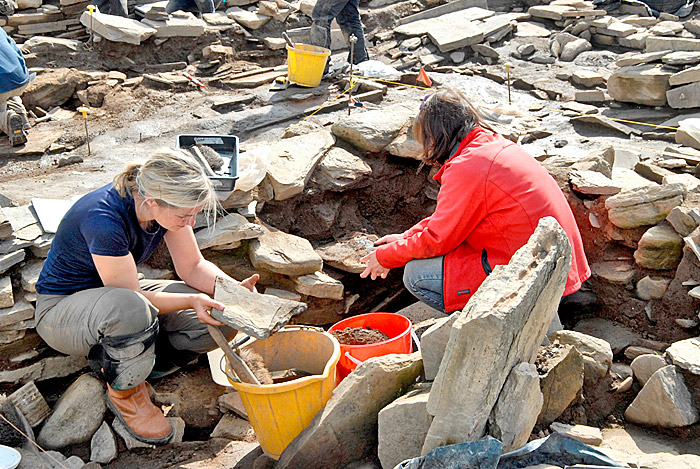 Georgie and Antonia had to partially dismantle a section of the surrounding wall to remove the decorated stone.
