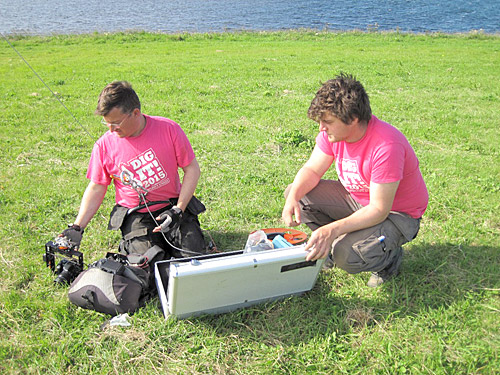 Hugo and Woody — the amazing duo from Structure Fourteen — prepare Hugo's kite-camera for launch.