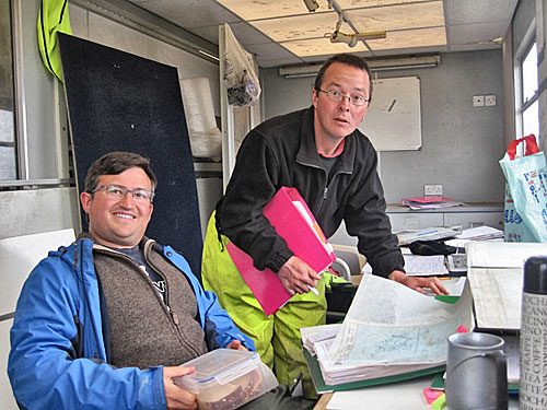 Hugo and Dave catch up on the paperwork associated with Structure Fourteen.
