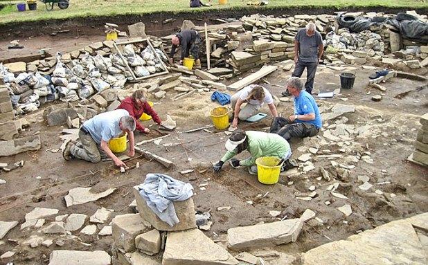 The Structure Twelve team hard at work, sampling the deeply stratified floor deposits.