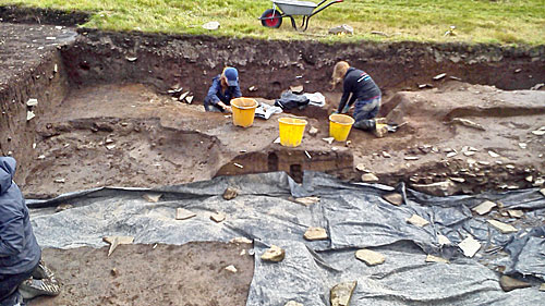 The last of the pits in Trench T are emptied of their infill and soon work can continue to reveal more of the potential chambered tomb at the door of the midden mound.