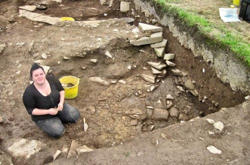 Melanie reveals more of the robbing on the mystery structure in Trench T.