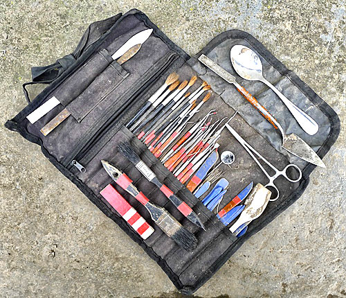 Supervisor Jim's tool roll - metal dental tools, plastic spatulas and four leafs!