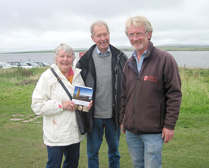 The 1,000th visitor today, Gloria Wallington, receives a signed guidebook from site director Nick Card.