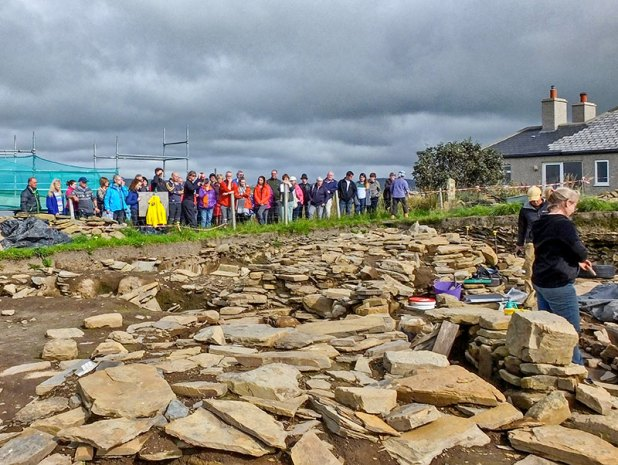 A group of site visitors watch the Ness of Brodgar archaeologists in action (Jo Bourne)