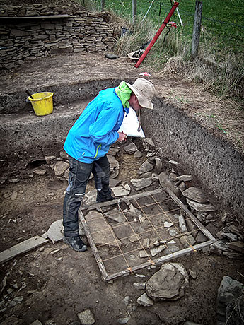 Emmanuelle planning a feature at the top of Trench T.