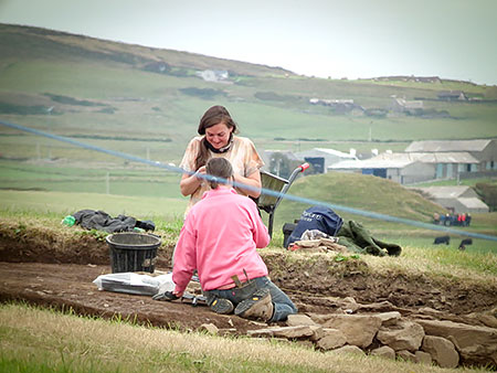 Excavating the Iron Age remodelling section at the top of Trench T.