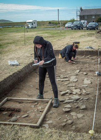 Arran and Doug on planning duties in Trench J.