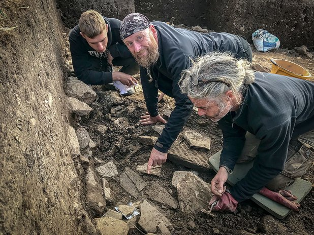 Declan, Mike and Marcus start the delicate process of excavating the whalebone found in Trench Y today.