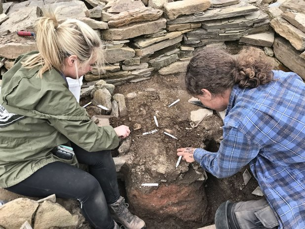 Natalie and Callum sampling the 1925 hole that produced the 'Brodgar Stone'.