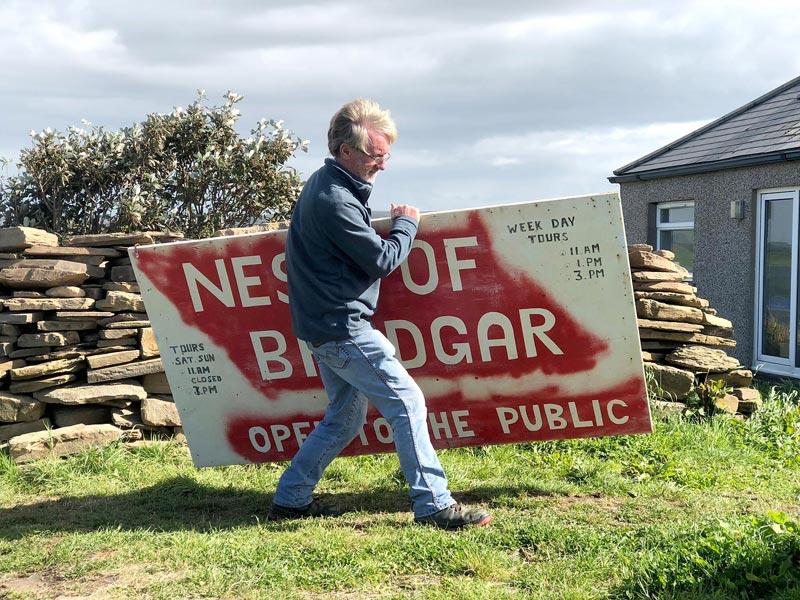 Site director Nick Card packs away the 'Open to the Public' sign at the end of 2019. We desperately need your help to make sure it sees the light of day again.