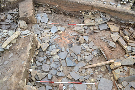 Demolition rubble overlying a large mound of burnt material in the SSE end of Structure Eight. (ORCA)