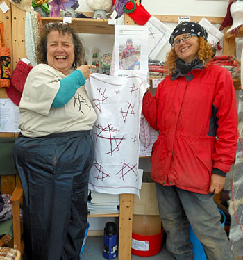 Jeanne (left) with excavator Jo and the Ness of Brodgar Butterfly tea towels.