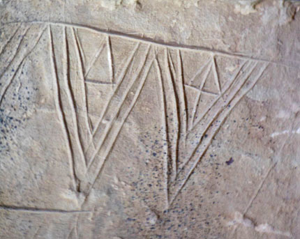 Detail of the triangular incised motifs from the large decorated stone found in Structure Ten in 2013. (Jeanne Bouza Rose)