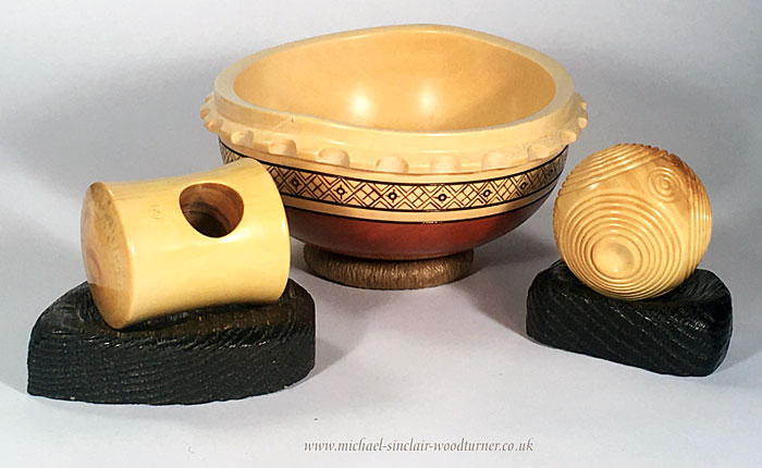 Recreated in wood - Michael Sinclair's macehead, round-bottomed bowl and petrosphere. (https://michael-sinclair-woodturner.co.uk/)