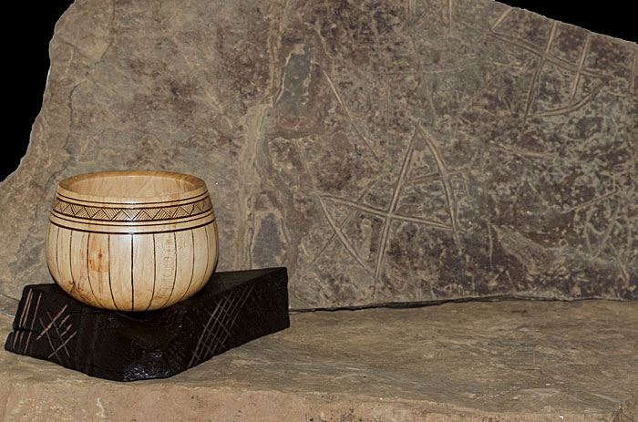 Inspired by the Ness - Sycamore piece, sitting on a hand carved ebonised elm base. The first fundraising offering in our new collaboration with Michael Sinclair Woodturning.