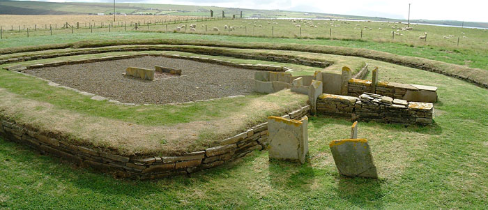 Structure Eight at Barnhouse with the Stones of Stenness in the background. (Sigurd Towrie)