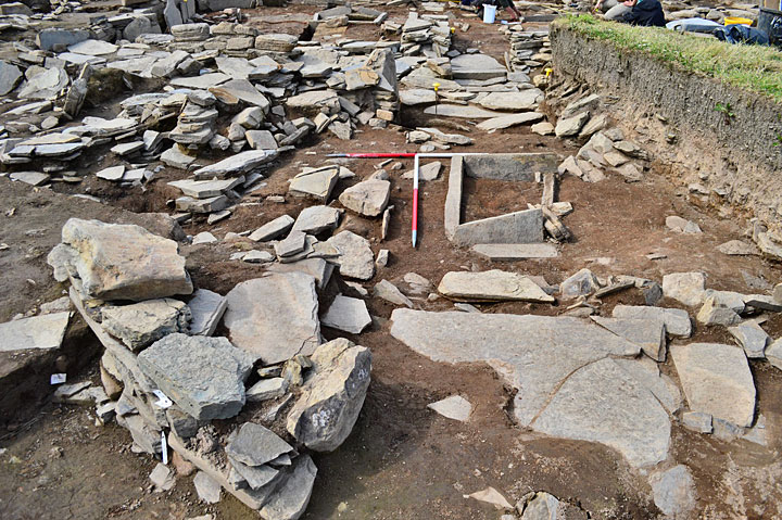 The heavily truncated remains of Structure Sixteen, looking north-west along its interior across the hearth towards its entrance. (ORCA)