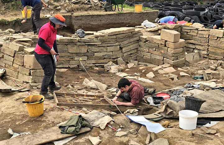 Clare and Jean-Luca at work recording and excavating Structure Twelve's floor deposits. (Sigurd Towrie)