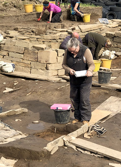 Jan at work on Structure Twelve's southern hearth. (Sigurd Towrie)