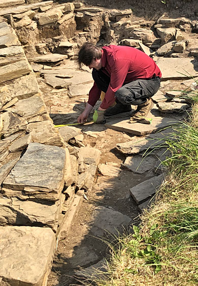 Ole at work outside Structure Twelve's southern wall. (Sigurd Towrie)