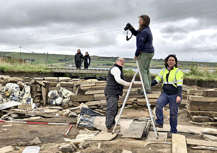 Jan, Jo and supervisor Clare photograph the post-holes discovered in Structure Twelve. (Sigurd Towrie)