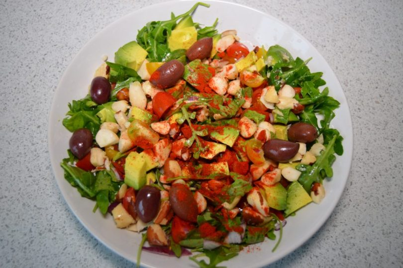 Rocket and Brazil Nut Mediterranean Salad on a bowl