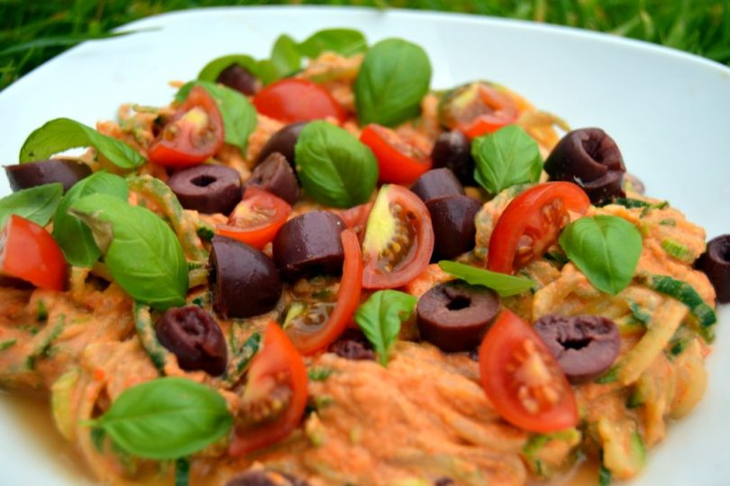 Creamy tomato Courgette Spaghetti topped with black olives