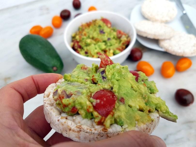 Easy delicious guacamole on a brown rice cake