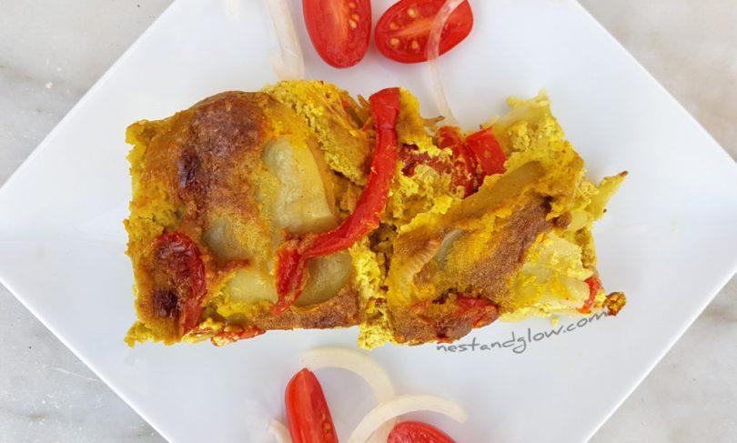 A slice of vegan cheese and tomato potato bake