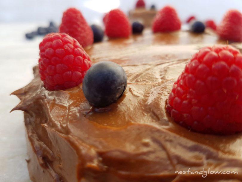 Quinoa Avocado Chocolate Fudge Cake With Berries Close Up