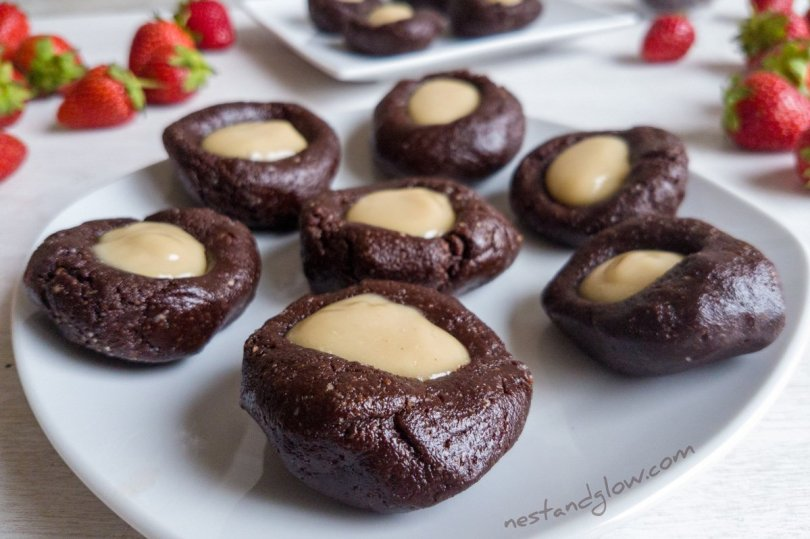 A plate of Raw Chocolate Cashew Thumbprints