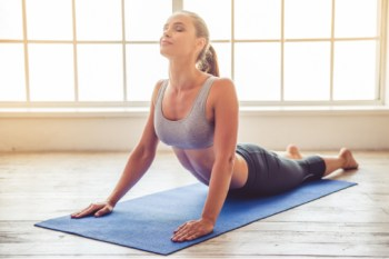 woman practicing yoga pose to become a yoga instructor
