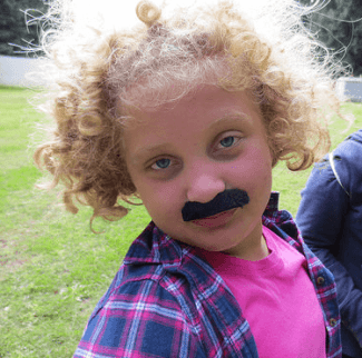 young girl with mustache