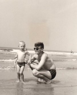 Father and son at the sea shore