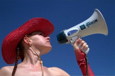 pretty girl holding a megaphone