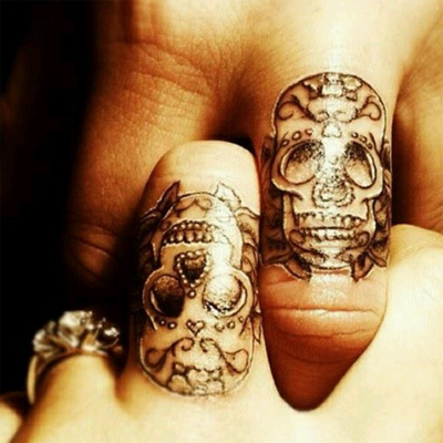 Skull-couple-tattoos-netmarkers