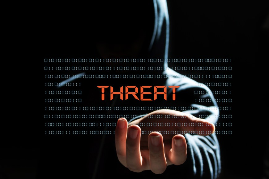 cyber hacker with  threat text icon
